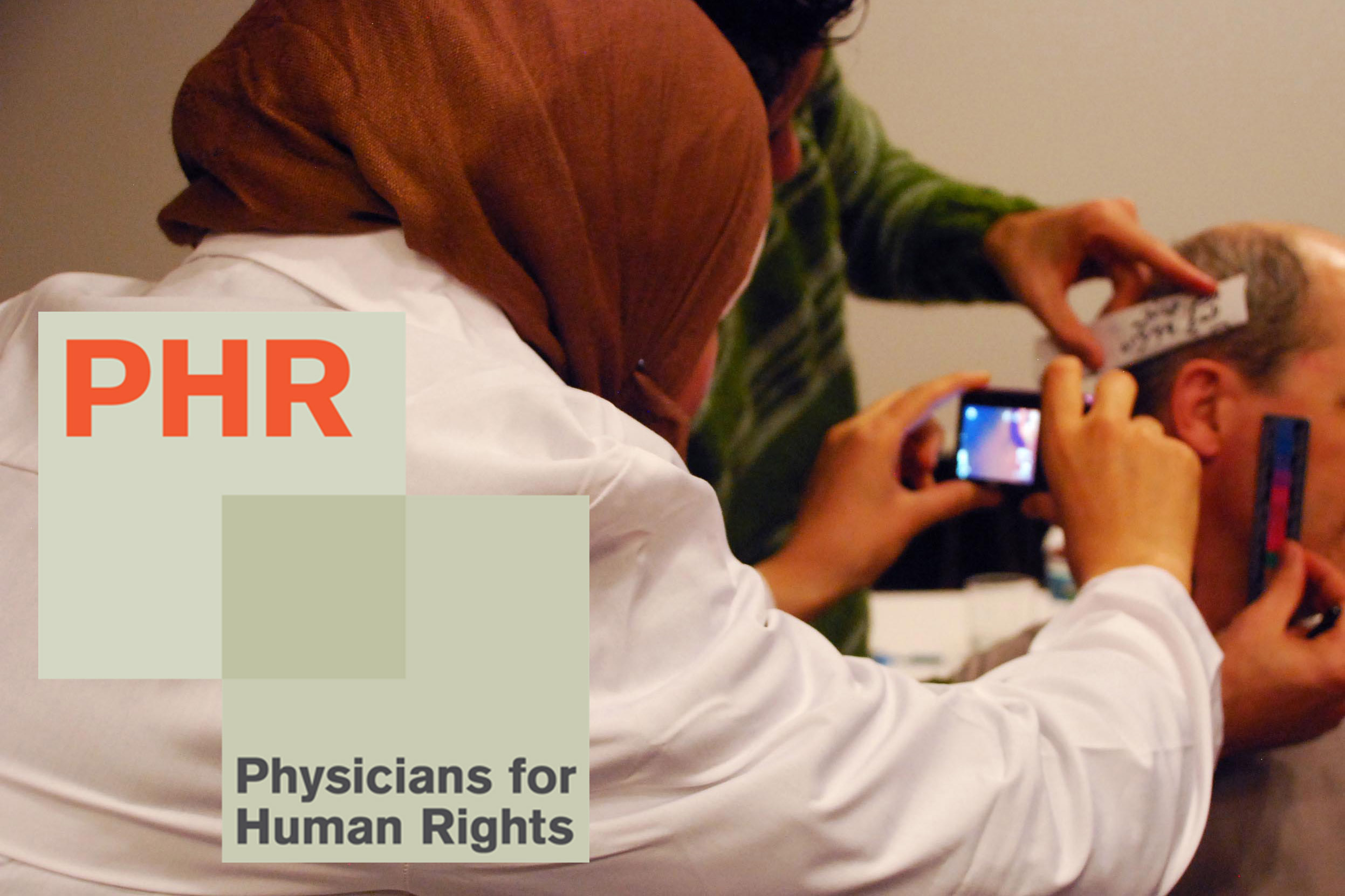 A Syrian physician being trained how to document evidence of torture. Physicians for Human Rights, which uses science and medicine to combat abuses and atrocities, will accept the award on Nov. 2. (Physicians for Human Rights Photo)